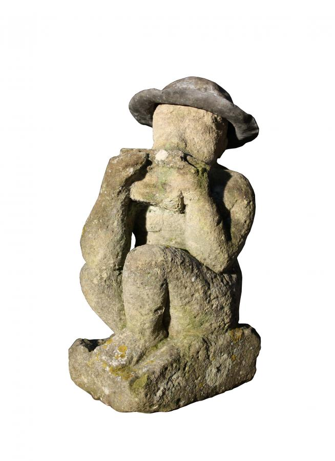 19th century carved Cotswold stone statue of a boy playing pipes