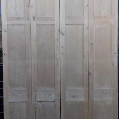 A set of pine bi-fold doors