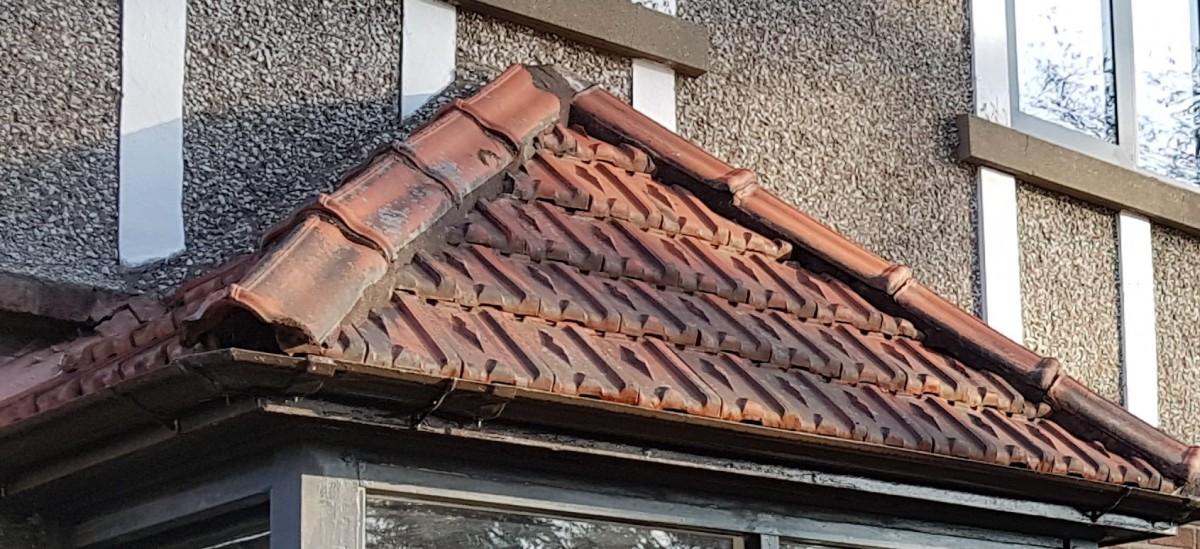 Decorative hip and ridge tiles, terracota, french.