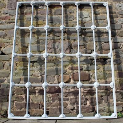 Victorian Tudor rose iron window