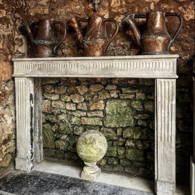 antique-french-stone-fireplace-1.jpeg