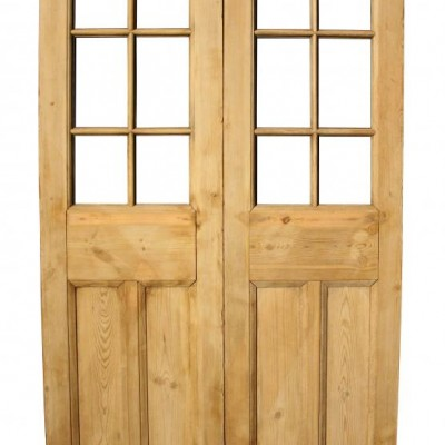 A pair of stripped pine exterior French double doors