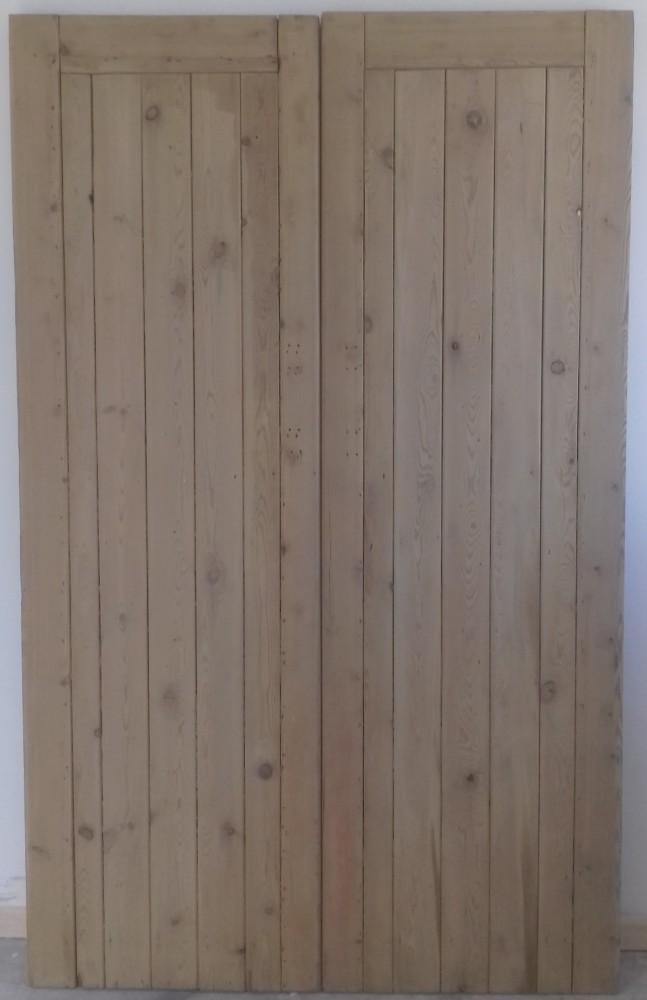 Framed ledged double doors in pine.