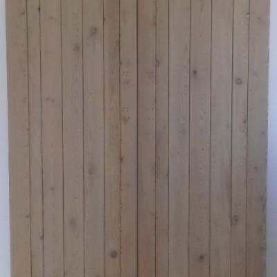 Framed ledged double doors in pine.