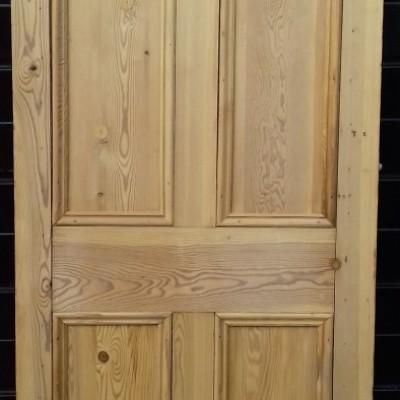 Narrow reclaimed 4 panel pine door.