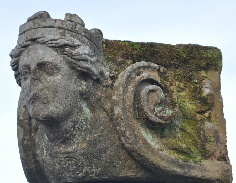 antique stone capital with figurehead