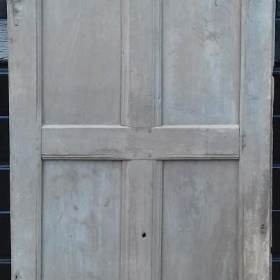 An early section of oak wall paneling / cupboard door.