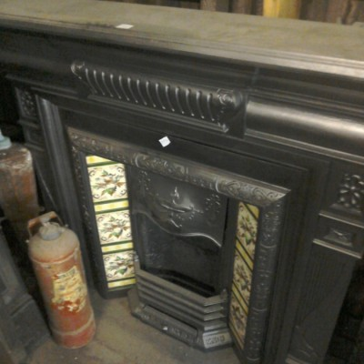 Cast iron surround and tiled insert