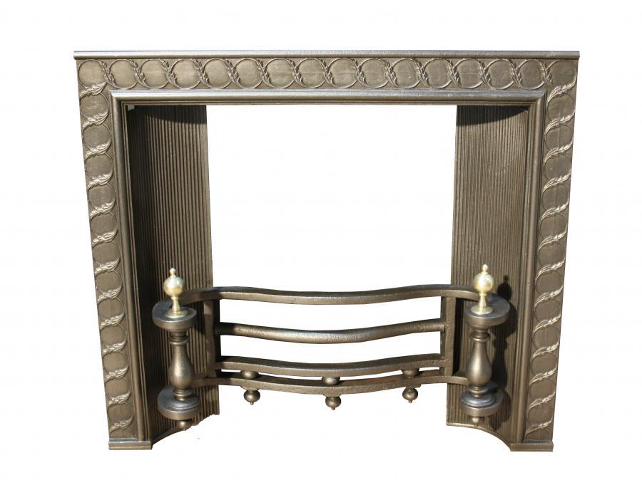 19th century cast iron and brass fire insert