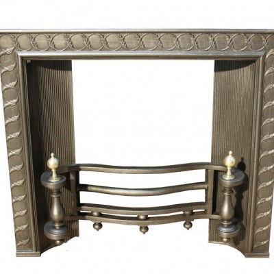 19th century cast iron and brass fire insert