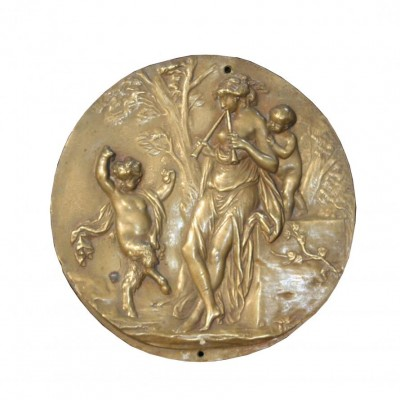An antique signed bronze wall plaque