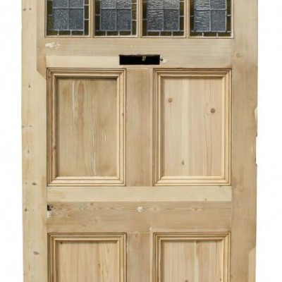 A late 19thC arched pine front door with stained glass