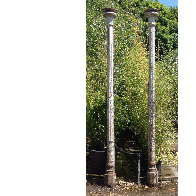 A Pair Of Antique Reclaimed Cast Iron Posts
