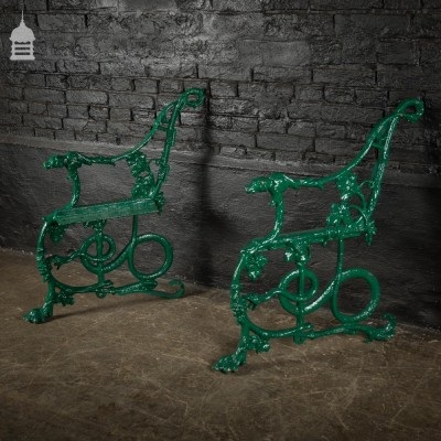 Pair of green Coalbrookdale design cast iron bench ends with hound and snake design.
