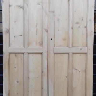 Pair of  rebated paneled cupboard doors