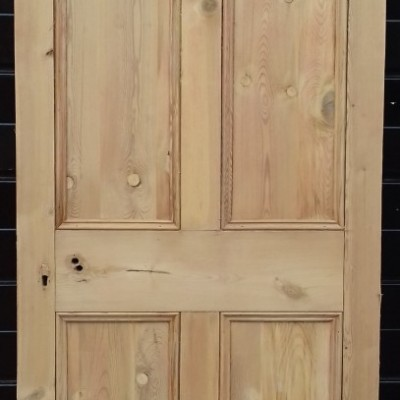 2 matching four panel pine doors