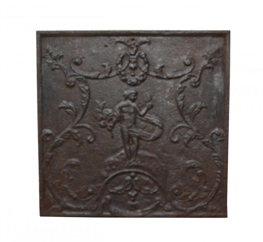 An antique French cast iron fireback
