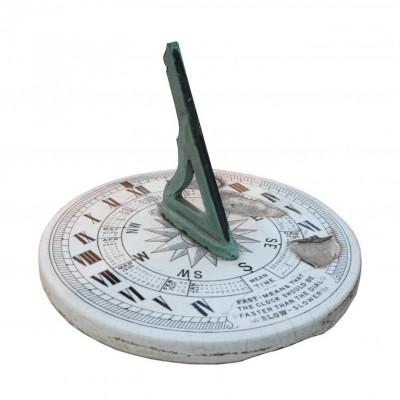 An unusual antique English ceramic sundial with bronze gnomon