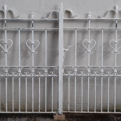 A set of antique wrought iron driveway gates.