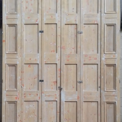 A very large pair of Victorian pine window shutters / room dividers.