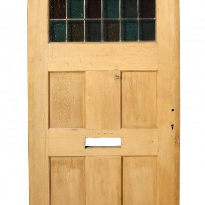 A reclaimed oak and leaded glass front door