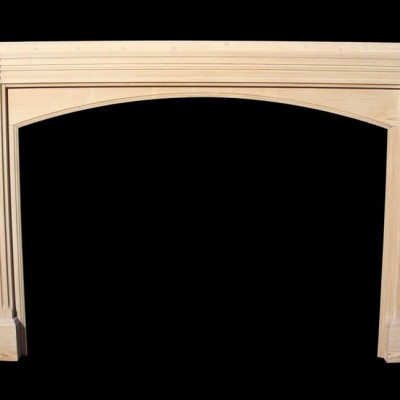 A late 19thC. stripped pine fire surround