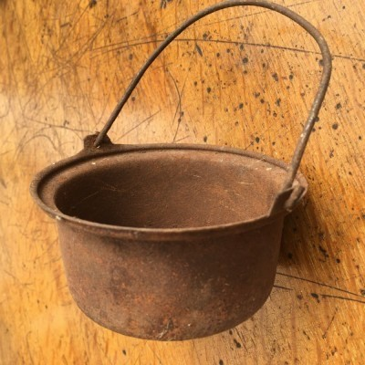 Small old steel pot with loop handle