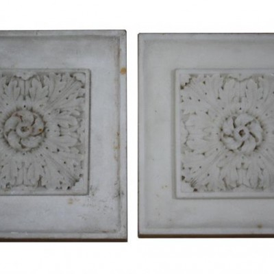 A pair of early 19th Century carved statuary marble end blocks
