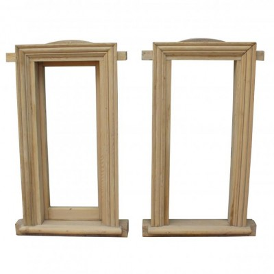 A pair of reclaimed stripped pine window frames