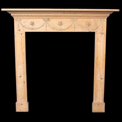 A late 19th C. pine and gesso fire surround