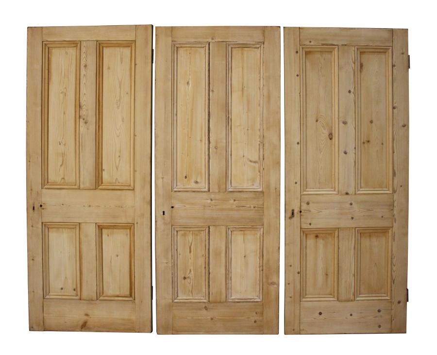 Three Victorian stripped pine four panel doors