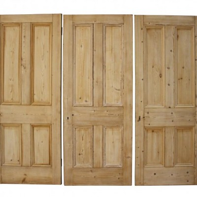 Three Victorian stripped pine four panel doors