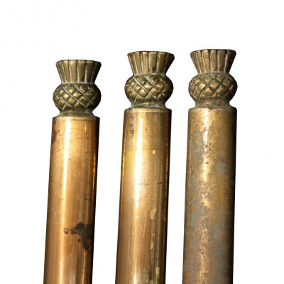 Three oval profile stair rods with Scottish thistle finials