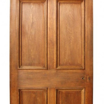 A large antique oak six panel door with marquetry panels