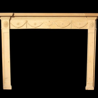 A 19th C carved pine fire surround