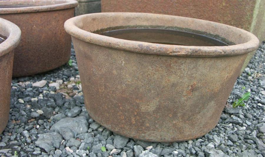 antique cast iron troughs circular x 3