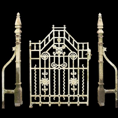 A Victorian cast iron gate with posts