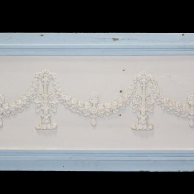 A painted French wall panel with applied decoration