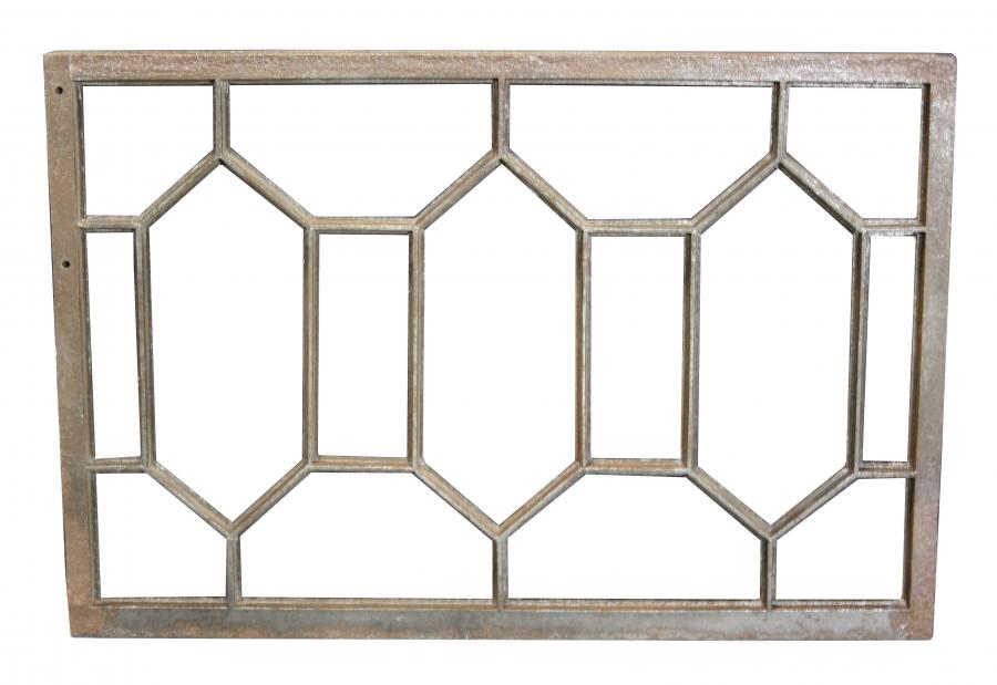 An antique cast iron window frame / grill