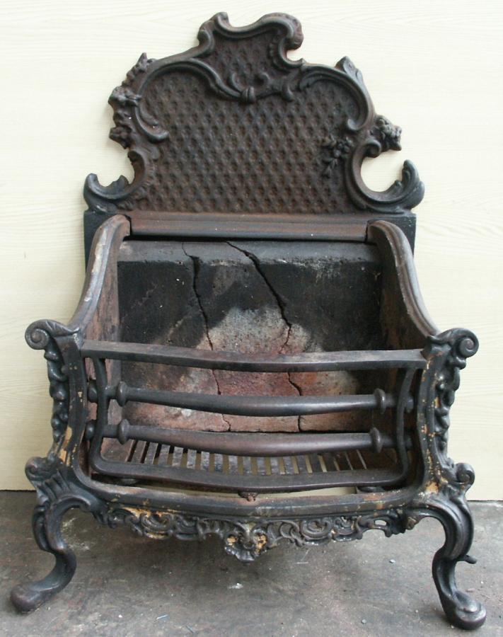 rococo antique cast iron fire basket