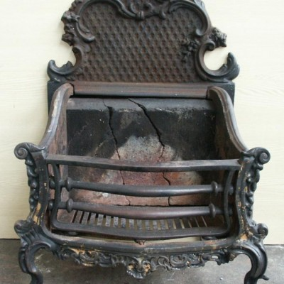 rococo antique cast iron fire basket