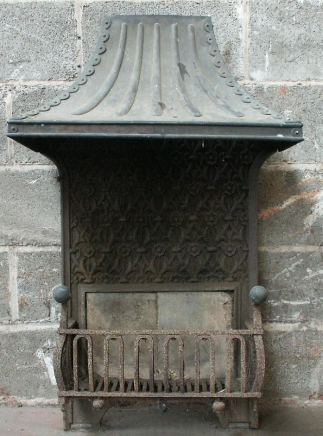 antique brass and cast iron firebasket