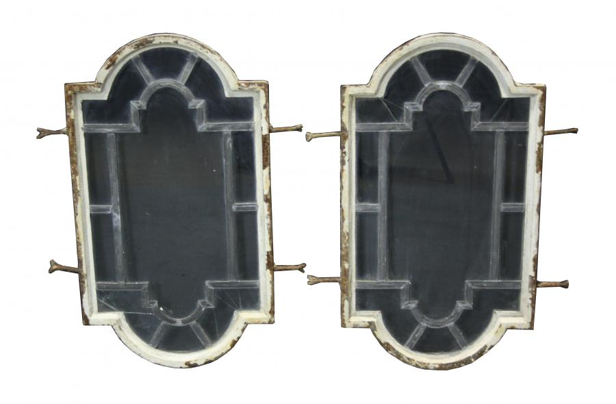 Pair of cast iron and leaded glass windows