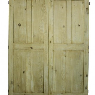 A pair of Victorian four panel pine doors