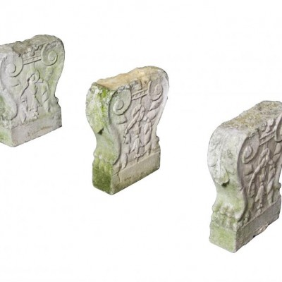 Three antique carved Portland stone bench supports