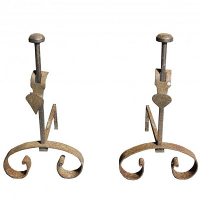 A pair of antique French wrought iron fire dogs