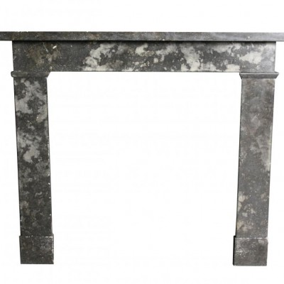 An early 19th C. mottled black/grey marble fire surround