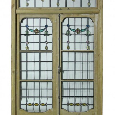 A pair of antique leaded glass French double doors with frame