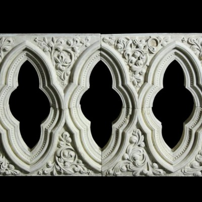 An antique English carved Caen stone window