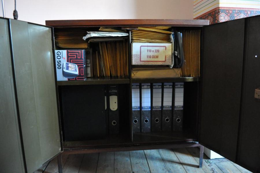 An antique steel office cabinet or cupboard mid century
